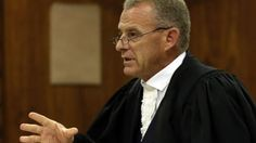 """Prosecutor Gerrie Nel has been accused of pursuing a """"personal vendetta"""" against…"""
