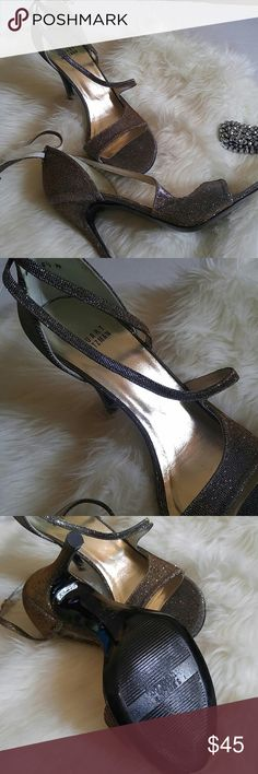 Glitzy Stuart Weitzman Party heels Very good condition. No flaws. Very classy design. Shimmery gold and silver with black undertones. 4 inch heel. Timeless design. Pictures are not doing these beauties any justice. Perfect for any formal occassion Stuart Weitzman Shoes Heels
