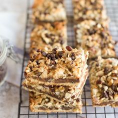 Gluten Free Seven Layer Bars are packed full of chocolate and coconut. Perfect for any party, everyone will enjoy these easy gluten free dessert bars! Gluten Free Pumpkin, Gluten Free Desserts, Easy Desserts, Gluten Free Recipes, Delicious Desserts, Dessert Recipes, Easy Recipes, Homemade Desserts, Healthy Recipes