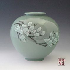 The Green Jar: Celadon Ceramic with Magnolia Blossom in Relief - Antique Alive