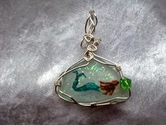 Hand Painted Sea Glass Pendant: The Mermaid that Swims in the Glittery Sea Finds the Jewel by Adele Whittle (Tiddu), via Flickr