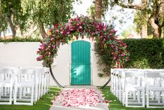We loved how this circle wedding arch framed the famous gate to the popular Greta Garbo residence for this weekday wedding in Palm Springs.