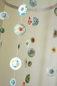 glue buttons onto a circle paper garland