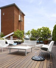Perfect for rooftop entertaining: Grillage seating collection. Also pictured is the Lau tray (on floor), new Grillage tables, and Giardinetto plant holders.