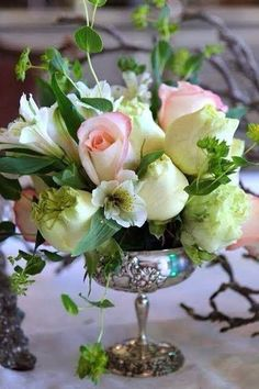 The only thing that could make this Floral arrangement more gorgeous is the Sterling footed bowl embossed with fruit.