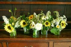 Jam jar posies in lemon and white. Strictly seasonal British eco wedding flowers by Common Farm in Somerset.