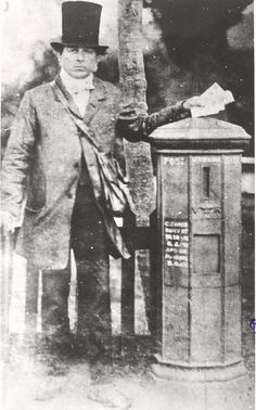 Postman and pillar box, late 1850s by British Postal Museum & Archive.