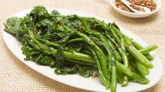 . Garlic-Sauteed Rapini. I par boil rapini, drain water and set aside. Return pan to stove, add olive oil, and 4 - 5 crushed garlic cloves, add some pine nuts and toast till light brown. Return rapini to pan and saute for 5 -7 mins on high.  Great taste.