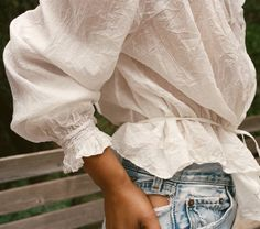 In 100% cotton voile, the DOEN Lille Top is our updated take on the traditional Edwardian lawn blouse. The whisper thin crinkled cotton voile construction is accented with delicate pin-tucks and pleat