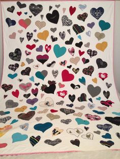 This quilt, I made for a woman who lost her mother. She wanted the whole quilt filled with hearts. There are over 180 hearts on this quilt which I machine stitched down with a zig zag pattern. It measures 70 x 87. I also made 2 pillows from the left overs. I did a bit of a shadow stitch around each heart and filled in the rest. I enjoyed doing this quilt as I do all my memory quilts.