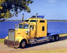 This cheerful image will bring a sense of warmth to any home. Your home surely will brighten up with the presence of this yellow semi big rig diesel truck art print poster. This beautiful semi big rig truck poster will work with all décor style. This poster captures the image of yellow semi big rig diesel truck parked near the ocean which is sure to grab lot of attention. So why wait, grab this wonderful wall poster for its perfect quality and amazing color accuracy.