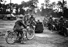 Seven or eight machine-gun crews are ready to set out on a sortie in France, ca. 1918. Each crew consists of two men, the driver on a motorbike and the gunner sitting in an armored sidecar.
