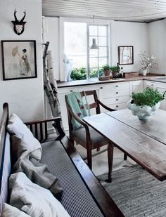 This would be neat to do white cabinets with dark butcher block counters & rustic table.