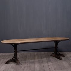 Oval table with metal legs.