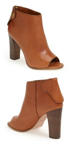 Lusting after this Coach leather bootie. The beautifully styled snap tab covers the zip.
