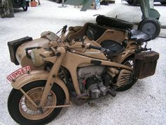 This Zundapp KS 750 motorcycle with sidecar was one of the workhorses of light motorized German infantry throughout WW2. This particular museum specimen is powered by the classic BMW Boxer motor that is still in production today. The side car rider had the option of mounting a machine gun on the front of the car for added firepower. These motorcycles carried three grenadiers and their use aimed at deploying well-armed troops at maximum speed and surprise.