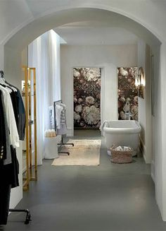 Kara Mann's Tip 6  USE SMALL ROOMS TO TAKE BIG RISKS. A wallpaper pattern that would overwhelm your living room will be fabulous in your powder room or a small foyer. At goop Pop: wallpaper by Ellie Cashman, étagère, side table, rug, and basket from Jayson Home.