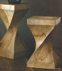 "Blond mango wood creates these casual, twist-shaped stools, which do double duty as display stands or end tables. Because they are carved from a single piece of wood, some degree of ""checking"" (radial cracking along the grain), which occurs in massive wood pieces of these sizes, is expected."