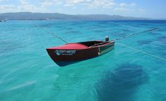 Small fishing boat at Doctor's Cave Beach in Montego Bay, Jamaica