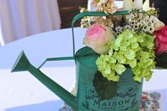 Bits n Bobs: rustic baby shower decor. watering can flower arrangement.