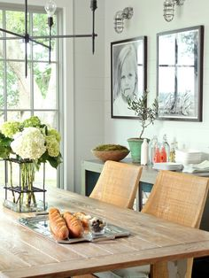 Love the large portraits above buffet for dining room