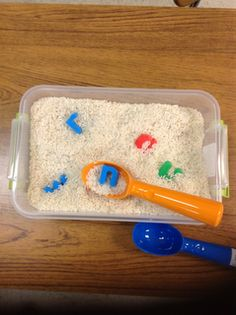 Conversations in Literacy: What kid doesn't like to dig in stuff and find hidden treasures?What if those treasures were the letters in their name?I filled a small container with rice for this, but you could use beans, sand, or even pom pom balls.Then hide the letters and watch them dig!