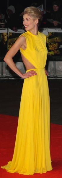 Rosamund Pike in London wearing a bright yellow Alexander McQueen Spring 2013 gown