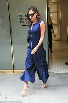 Saucy: The fashion designer flaunted her cleavage in the quirky look with edgy silver zip detailing
