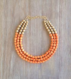 Hey, I found this really awesome Etsy listing at https://www.etsy.com/listing/130177433/orange-gold-statement-necklace