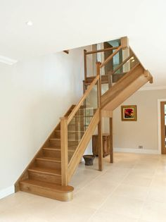 This recent hallway project in Esher features clear toughened glass. Staircase Railings, Wooden Staircases, Curved Staircase, Modern Staircase, Staircase Design, Loft Staircase, Banisters, Stairways, Oak Stairs