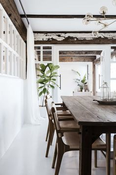 Exposed woodbeams tie in with the rustic dining table and chairs.