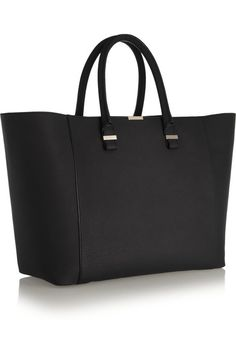 7fe3788bac47 Victoria Beckham s  Liberty  tote is perfect for overnight business trips.  Handcrafted in Italy