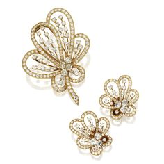 18 Karat Gold and Diamond Brooch and Earclips, Van Cleef & Arpels, France   lot   Sotheby's