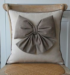 this pillow is darling! and easy to make. simple pillow and sew on a nice bow