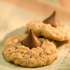 Skippy Cookie Kisses Recipe Desserts with quick-cooking oats, all-purpose flour, baking powder, baking soda, salt, skippi creami peanut butter, Country Crock® Spread, granulated sugar, firmly packed brown sugar, large eggs, vanilla extract, chocolate candy