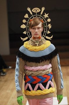 "This was designed by Belgian Walter Van Beirendonck, who in 1999 was awarded the honorary title of ""Cultural Ambassador of Flanders"". Maybe the committee were inspired by Dame Edna?"