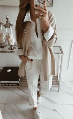 awesome comfy outfit_white shirt + pants + sneakers + beige pullover Having enough office outfit ideas when you don't have to adhere to a uniform is about as tricky as a dress code gets. How casual is too casual? Mode Outfits, Office Outfits, Fashion Outfits, White Shirt Outfits, White Shirts, Office Fashion, Work Fashion, Classy Outfits, Stylish Outfits