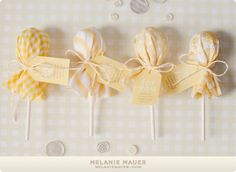 Lollipops covered in coordinated fabric and secured with thank you tag