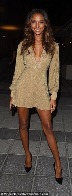 Turning heads: Justin Bieber's former fling Chantel Jeffries rocked a dusky pink trench coat as Jasmine Tookes stunned in a plunging gold dress
