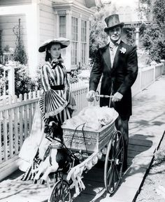 Clark Gable as Rhett Butler and Vivien Leigh as his wife, Scarlett O'Hara Butler out walking their baby, Bonnie, in 'Gone With The Wind'