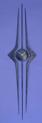 contemporary wall clock in metal by Paul Margetts