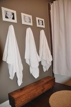 Bathroom gray-room. Love the pictures indicating who has each towel!