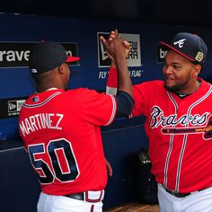 Juan Francisco is greeted by Christhian Martinez before the game against the LA Dodgers