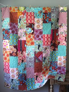 Anna Maria Horner Dowry Quilt This one of a kind quilt is completed and ready to ship to you! It is made using fabrics from Anna Maria Horners Dowry and other collections, and features a beautiful, bohemian mix of florals and geometrics in a jewel and earth palette. The binding is made from a vine print fabric and is machine stitched to both sides for durability. The batting in the middle of the quilt is 100% cotton that is thin and lightweight, but also warm. This quilt is backed in a…