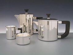Modern sterling silver tea set with ebony handles.