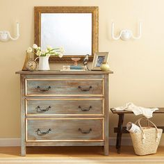 Aged to Perfection: Bring signature style to a basic white dresser with a few coats of dry-brushed paint and a set of antique handles. Milk paint provides this dresser with a rich-looking finish, and narrow trim on the drawers gives the once-flat structure dimension. Antiquing glaze rubbed over the entire surface completes the transformation.