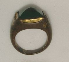 Probably Italy 15th century Bronze-gilt ring, the bezel set with pyramidal green paste, the shoulders engraved with scrolls 19.96 mm internal ring diameter; 29.09 g weight Castellani collection, 1884 Presented by Dr C.D.E. Fortnum in honour of Queen Victoria's Diamond Jubilee, 1897; WA1897.CDEF.F788 Taylor Scarisbrick, Finger Rings from Ancient Egypt to the present day, 1978, no. 464
