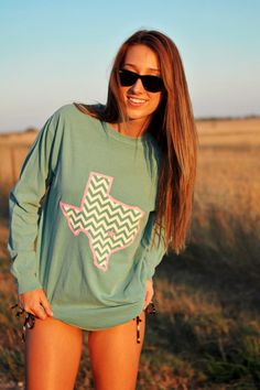 Seafoam Comfort Colors long sleeve with pink and white Texas Chevron! San Marvelous written along the left sleeve. The shirt fits true to size and is extremely comfy!