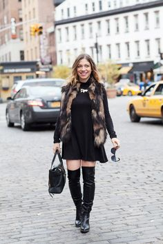 How to style over-the-knee boots: Opt for a dress or tunic that hits right at the thigh and allows a bit of breathing room between your boots and hemline