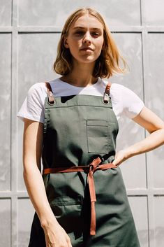The Tom Bib Apron in Forest with Black Straps takes sophistication to a new level. Designed in our shorter, edgier length, it is the perfect apron for crews on the go Cafe Uniform, Waiter Uniform, Cafe Apron, Shop Apron, Staff Uniforms, Work Uniforms, Chef Dress, Restaurant Uniforms, Restaurant Aprons